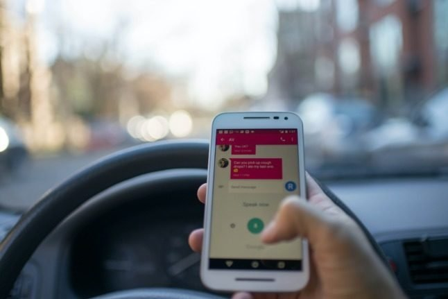 Spain eyes fines for drivers distracted by phones, even if they're not using them